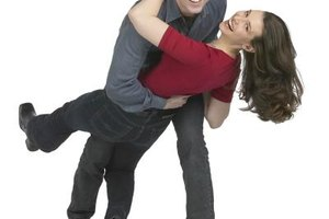 Engage in a fun activity like dancing to ease your wife's stress.