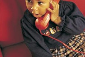 A toy or old phone is extremely useful in teaching children phone numbers.