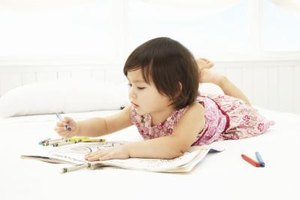 She loves to draw shapes, and showing her how to use stencils will help her fine-motor skills.