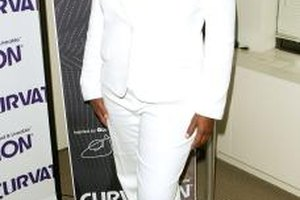Queen Latifah rocks a suit with straight leg trousers for a long, lean look.