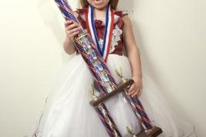 Work out the details to create a beauty pageant for little girls in your community.