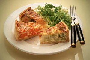 Quiche can be made with a variety of ingredients mixed in its base of eggs, milk and cheese.