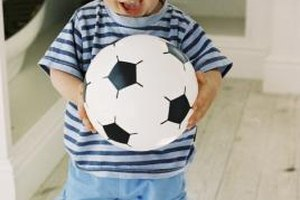 Don't worry if you can't keep your toddler from picking the ball up with his hands. Just have fun!
