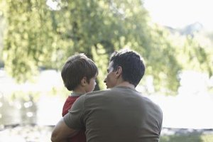 A fathers helps his children make important decisions, stimulating their cognitive growth.