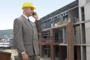 A construction company owner inspects building projects.