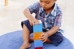 Help your child learn via playing with blocks.