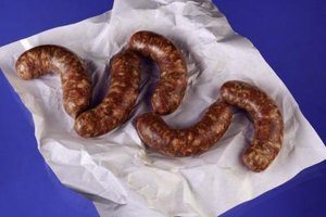 Roast Italian sausage whole or cut it into serving-size pieces.