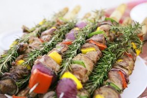 Serve kabob skewers with a mix of veggies and meat.