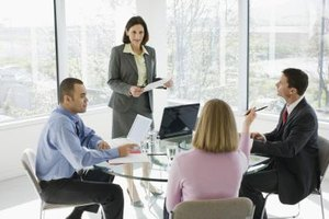 Corporate officers cooperate to solve their company's problems.