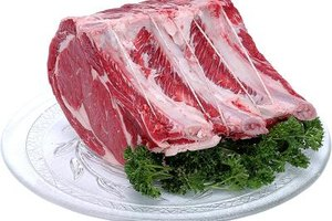 A three-bone cut from the loin end of standing rib roast has the most meat and least amount of fat.