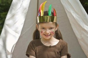 Create a birthday party with an Indian theme using such items as an Indian headdress.