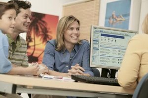 A travel agent spends at lot of time working at the computer.