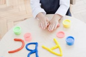 Kids can reinforce letters and numbers while using modeling clay, too.