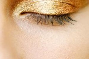 Applying a metallic powder eye shadow wet gives a pretty foiled effect on the lid.