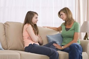 Encourage your teenager to talk out her problems.