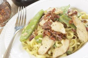 Tender, juicy chicken breasts add protein to pasta meals.