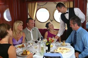 Cruise ship food service managers earn more in states where major port cities are located.