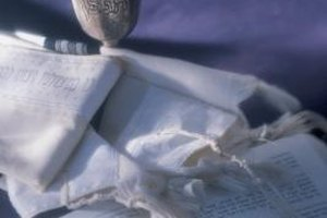 A tallit is often worn when reading sections of the Torah aloud.