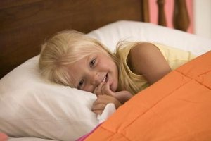 Calming your child before bed is essential to achieving good sleep for both you and her.