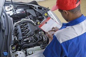 Auto electricians train to fit cars with electrical devices.