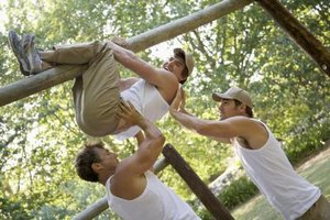 Have your teen group help each other through an obstacle course.