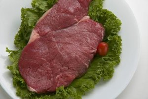 Sirloin steaks should be dark red with a light marbling of fat.