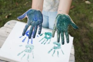 Turn painted hand prints into spring flowers.