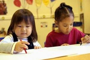 Preschoolers can share crayons and help each other when asked.