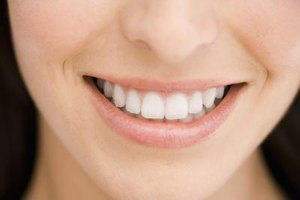 Use household baking soda to brighten your smile.