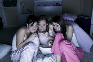 A fright-night theme is one of many enjoyed at sleepovers for young teens.