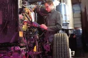 Diesel mechanics work on heavy vehicles such as tractor trailer trucks.