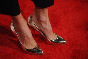 Stacy Kiebler accessorized a cropped tuxedo pant with shiny-gold pointed-toe pumps.