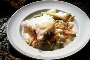 Pair baked hake with sauteed vegetables and a simple sauce for a complete meal.