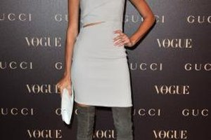 Supermodel Joan Smalls shows a sophisticated edge in a sheath and suede over-the-knee boots.