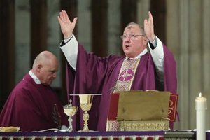 Cardinal Timothy Dolan in purple robe on Ash Wednesday, the first day of Lent.