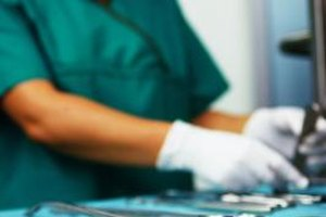 One of the duties of a surgical assistant is to prepare equipment needed for surgery.