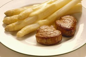 Pair white asparagus with fillet of pork and a delicate cheese sauce.
