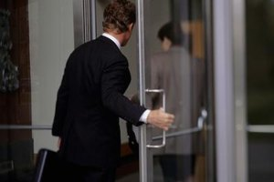 An unsecured business door can be a hazard.