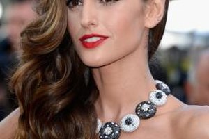 Model Izabel Goulart wears a strapless dress and statement necklace to The 66th Annual Cannes Film Festival on May 24, 2013.