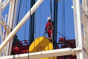 Derrick hands often have to wear safety harnesses when installing and repairing derricks.