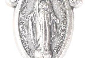 Religious medals are often attached to chains or rosaries.