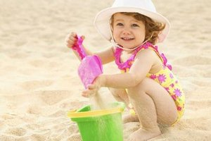 A bucket and a shovel can mean hours of bliss for your toddler.