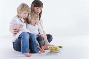 Help your young child to explore different toys and textures.