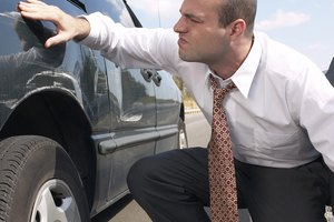 How Do Insurance Adjusters Come Up With a Settlement Amount on an Auto Accident?