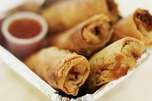 Fried spring rolls are made with a rice-based wrapper.