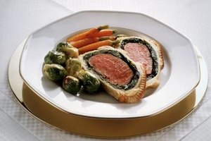 Traditional beef Wellington is surrounded by a puff pastry crust.