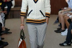 A v-neck, cable-knit, white sweater is a nouveau-prep style essential.