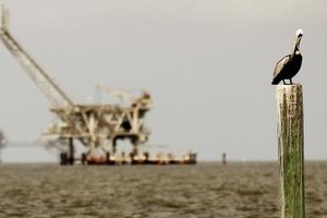 Drillers supervise the drilling operations during offshore oil exploration.