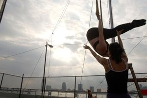 A trapeze class is an exciting option for teens visiting New York.