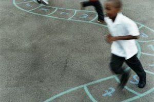 A game of hopscotch promotes gross motor development.